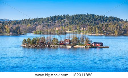 Small Island With Red Wooden Houses