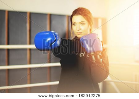 Beautiful Boxing Girl Performs Strong Punch In The Ring. Training At The Gym. Sporty Female Doing Bo