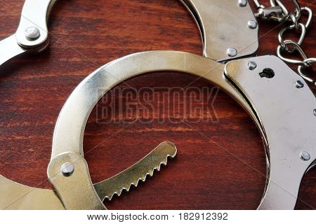 Handcuffs on the table. Punishment and crime conept.