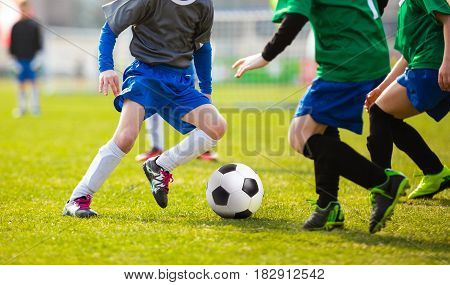 Football Soccer Match for Children. Kids Playing Soccer Game Tournament. Boys Running and Kicking Football Ball. Soccer Pitch in the Background