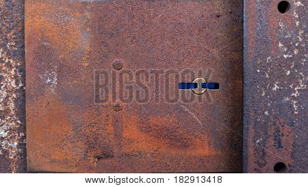 Old steel folding door And the keyhole is rusty