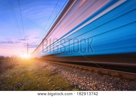 High Speed Blue Passenger Train In Motion On Railroad