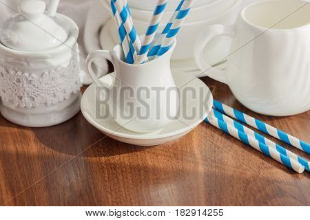Set Of White Empty Tableware With Striped Tubules