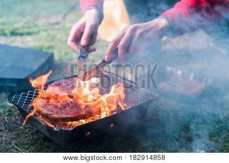 striped mutton steak on non-permanent foil grill closeup