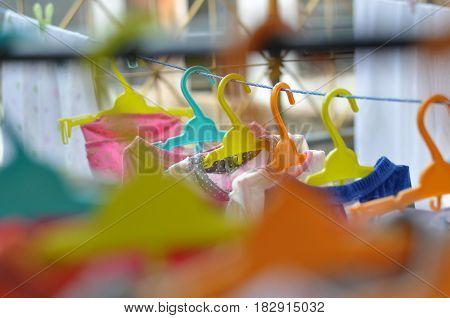 The colorful hangers are arranged in a neat and orderly manner