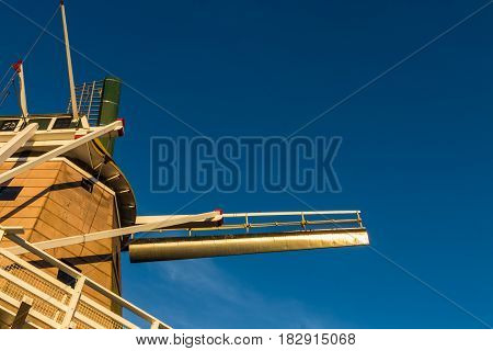 Looking up at Foxton windmill with a blue sky.
