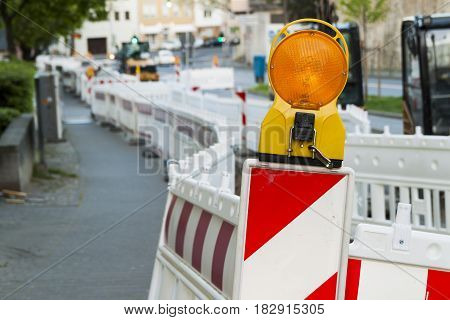 Orange construction Street barrier light on barricade. Road construction on the streets of European cities. Germany. Mainz.