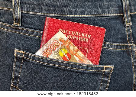 Moscow Russia - November 27 2016: Russian passport money and credit card MasterCard sticking out of the back jeans pocket. Travel concept