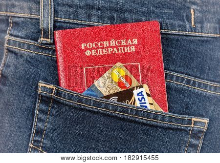 Moscow Russia - November 27 2016: Russian passport credit cards MasterCard and Visa in back jeans pocket. Travel concept