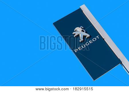 Samara Russia - MAY 14 2016: Official dealership sign of Peugeot against the blue sky background. Peugeot is a French car brand automotive manufacturer