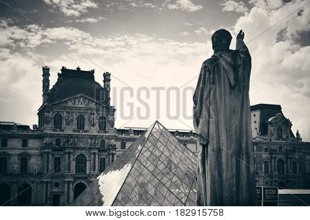 PARIS, FRANCE - MAY 13: Louvre with statue closeup exterior view on May 13, 2015 in Paris. With over 60k sqM of exhibition space, Louvre is the biggest Museum in Paris.