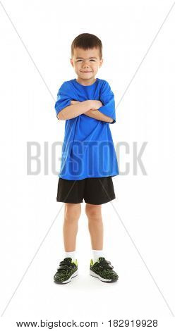 Little sportive boy posing on white background