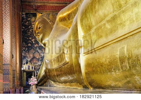 Bangkok, Thailand - December 7, 2015: Panoramic view of famous Reclining Buddha statue in Wat Pho Temple. Asian style Buddha Art