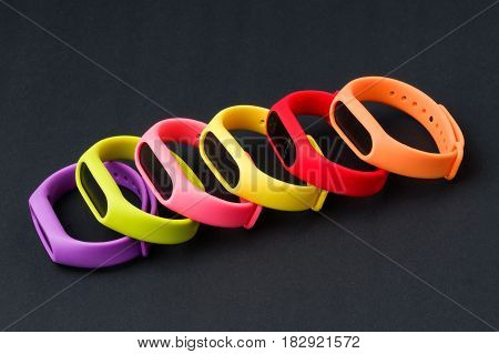 Set of colored fitness bands, isolated on black background