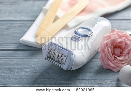 Set for epilation on wooden background, closeup