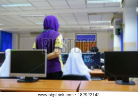 focus blur the student with teacher learning business technology desktop computer in a classroom