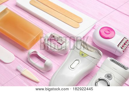 Set for epilation on wooden background