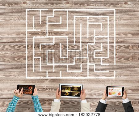 Group of people with devices in hands working together to find right solution
