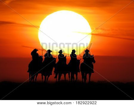 silhouette of cowboys and cowgirls in front of the sunset riding horses