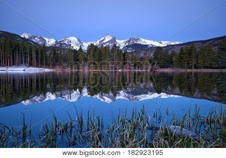 Pre dawn light on the Continental Divide and Sprague Lake located in Rocky Mountain National Park outside of Estes Park Colorado
