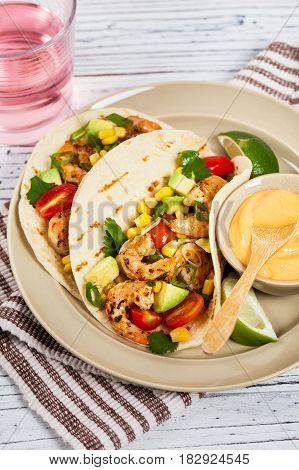 Tacos with Shrimp and Corn, Avocado Salsa. Selective focus.