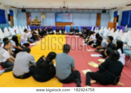 focus blur of business education seminar training conference in a meeting room sit on the floor.
