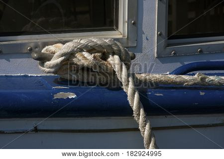 Mooring ropes holds weathered boat secure to dock in South Carolina