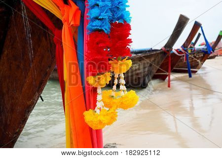 brightly coloured longtail boats on thailand beach