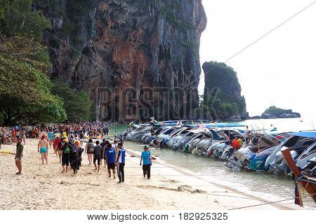 RAILAY BEAH, KRABI, THAILAND - 24 December 2016 : Tourists and speedboats flock to the famous pristine beaches of Thailand during the holiday season.