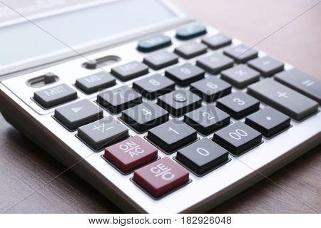 Calculator on table, closeup