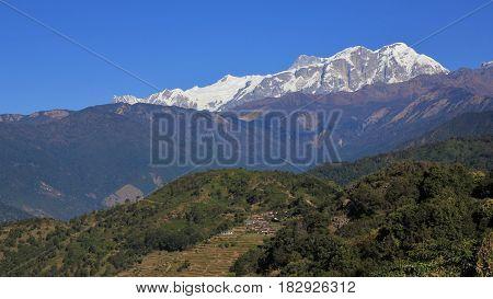 Annapurna range seen from Baglungpani Nepal. Green hills.