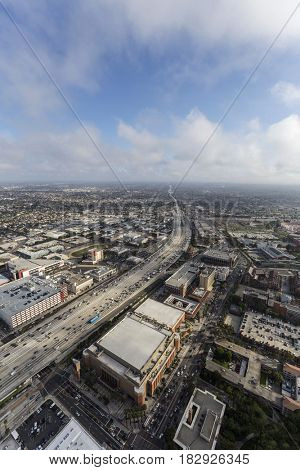 Aerial view of Harbor 110 Freeway with afternoon clouds in Los Angeles, California.