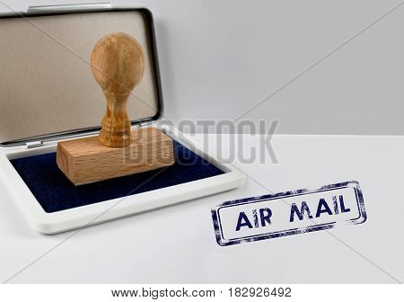 Wooden stamp on a desk AIR MAIL