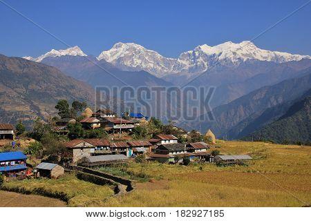 Landscape near Bhulbhule Annapurna Conservation Area. Village and snow capped Manaslu range.