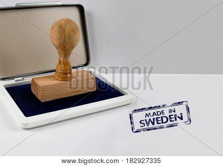 Wooden stamp on a desk MADE IN SWEDEN