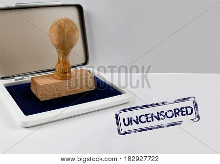 Wooden stamp on a white desk UNCENSORED