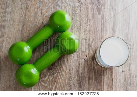 Two Green Dumbbells And Milk