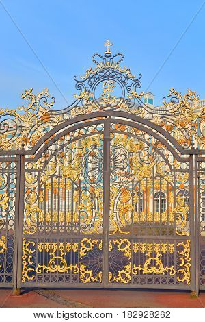 Gate of Catherine palace fence in Tsarskoye Selo with golden double-headed eagle suburb of St.Petersburg Russia.