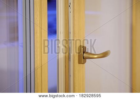 Detail of window handle on wooden window