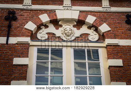 Statue above a window in amsterdam holland