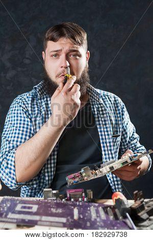 Male engineer repair pc motherboard