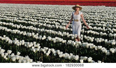 Smiling woman in tulip fields. Skagit Valley Tulip Festival. Mount Vernon. Seattle. WA. United States.