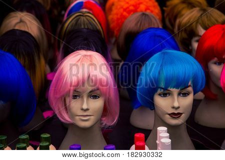 Colourful wigs on a mannequins head at a market in Amsterdam