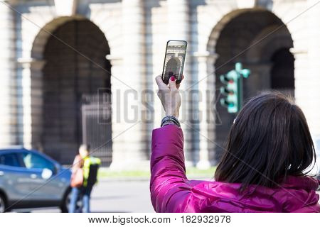 Woman In A City Taking Photographs With Transparent Phone
