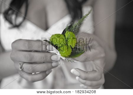 In the hands of the bride small flowers black and white photo with green bars