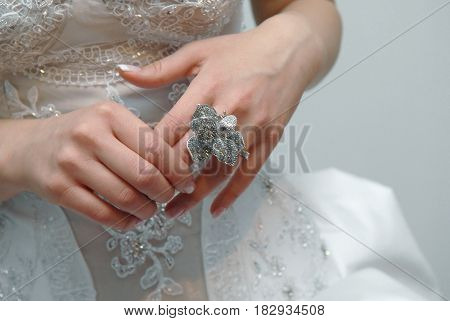 Wedding ring in bride's hands, Silver jewerly