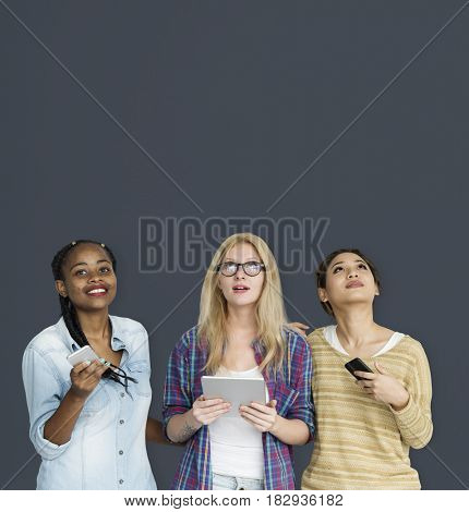 Group of Girls Using Technology Gadgets