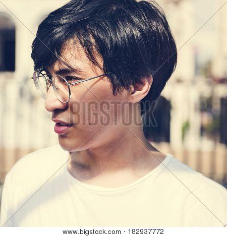Asian Guy Glasses Watching Focused