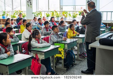 Children And Teacher In A Chinese Classroom