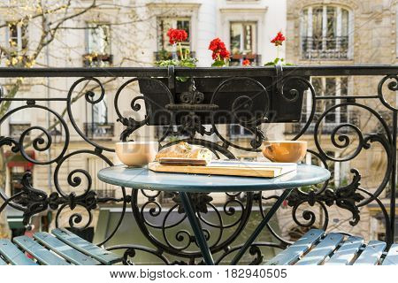 Breakfast on the balcony in Paris, France in springtime